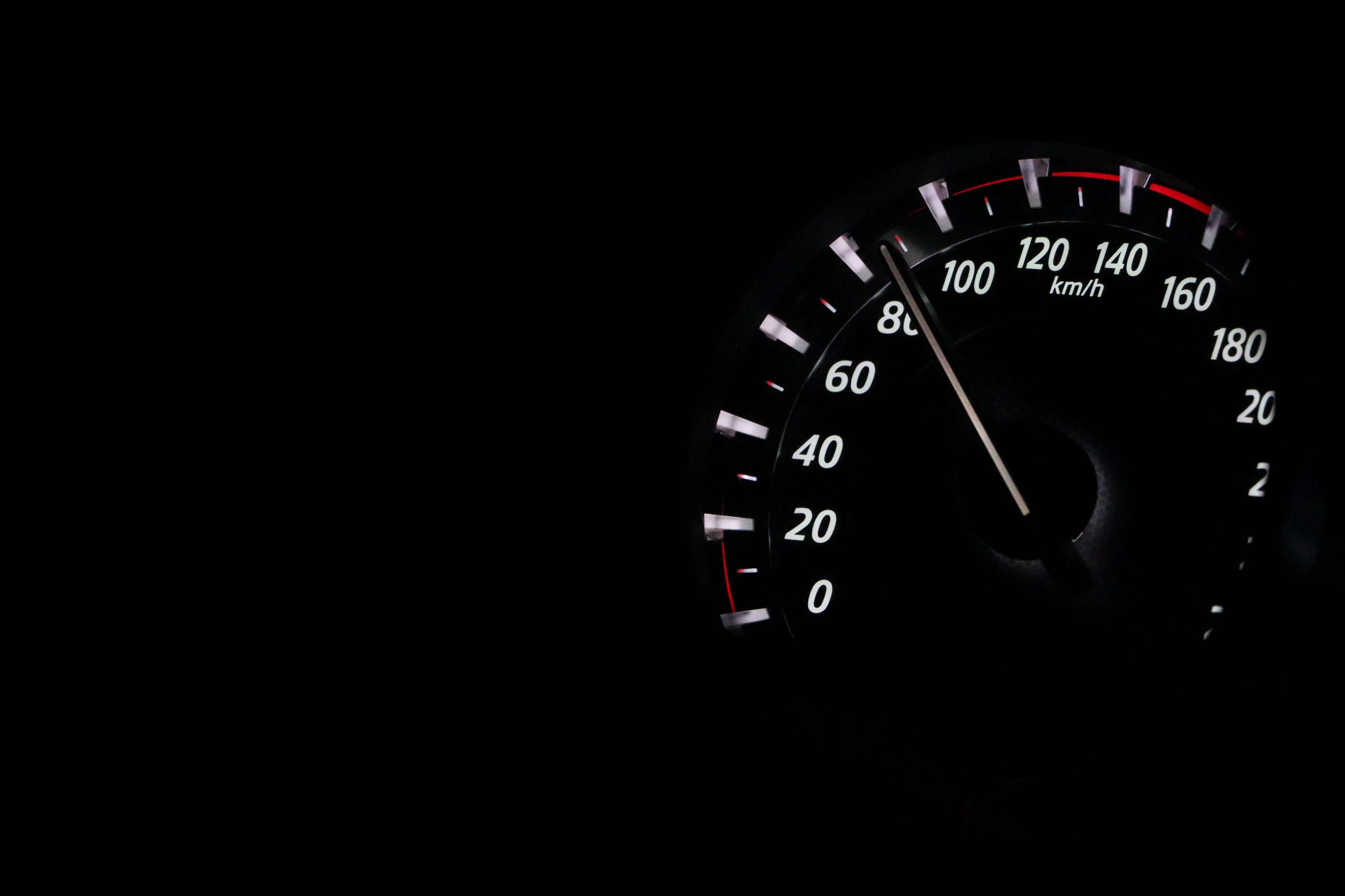 Speedometer showing over 80 mph at night